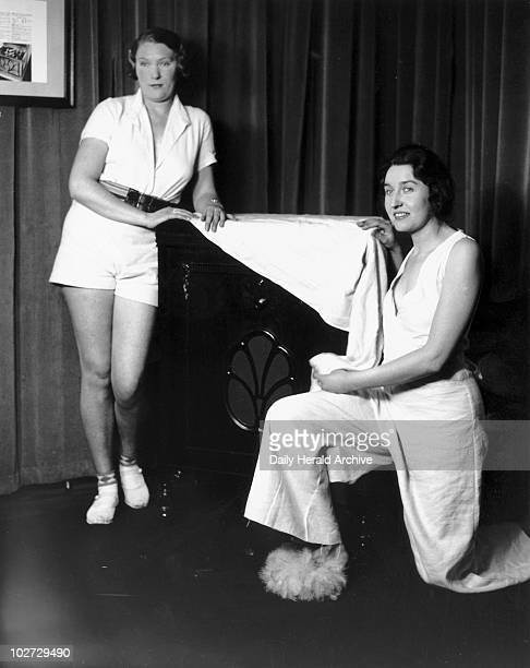 Women posing with the latest HMV gramophone 31 January 1933 The women are wearing clothes made from new packing cloth Photograph by Woodbine taken at...