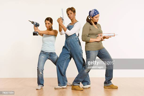 Women posing with tools