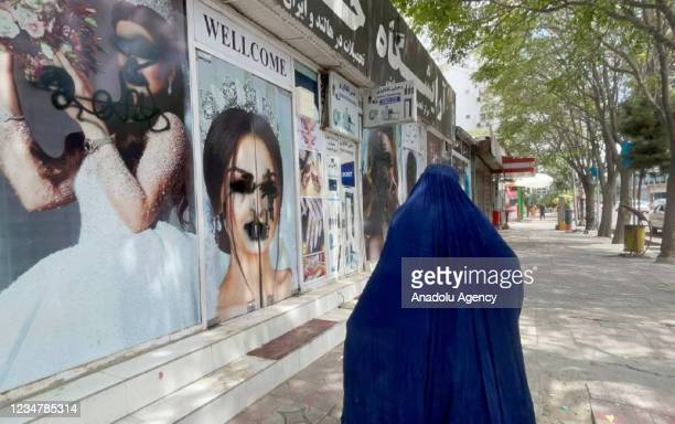 Women posters on beauty salon windows remain vandalized in Kabul, Afghanistan on August 20, 2021.