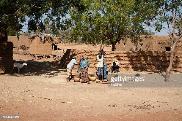 Women pounding millet in a village on the BamakoDjenne Road Mali