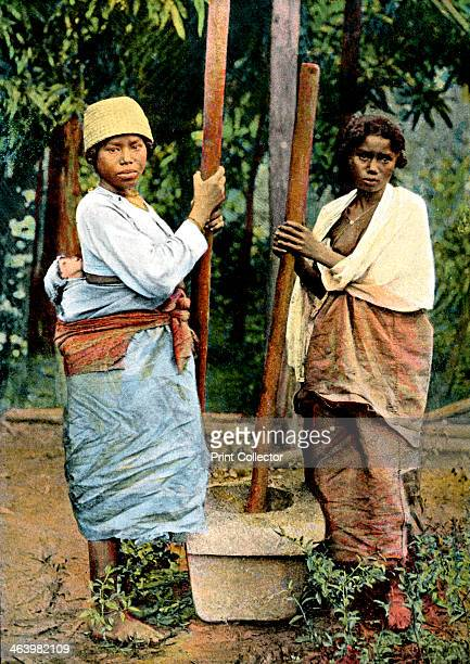 Women pounding rice Madagascar late 19th century Illustration from Island of Madagascar sites manners and costumes Paris