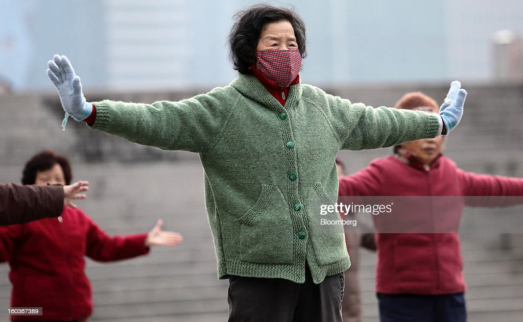 Women practice Tai Chi on the Bund in Shanghai, China, on Tuesday, Jan. 29, 2013. China's economic growth accelerated for the first time in two years as government efforts to revive demand drove a rebound in industrial output, retail sales and the housing market. Photographer: Tomohiro Ohsumi/Bloomberg via Getty Images
