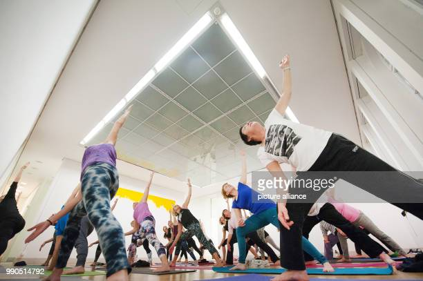 Women practice yoga during a yoga course at the Galery Stadt Sindelfingen in Sindelfingen Germany 11 January 2018 In the course of the exhibition...