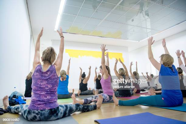 Women practice yoga during a yoga course at the Gallery Stadt Sindelfingen in Sindelfingen Germany 11 January 2018 In the course of the exhibition...