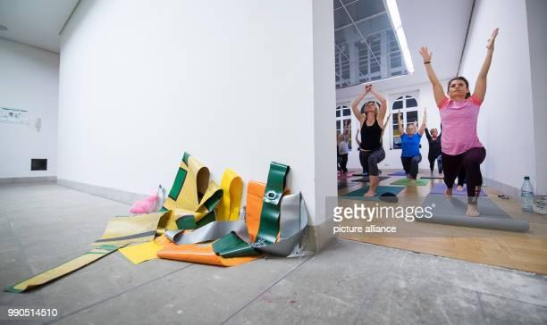 Women practice yoga during a yoga course behind the art work oto by Leni Hoffmann at the Gallery Stadt Sindelfingen in Sindelfingen Germany 11...