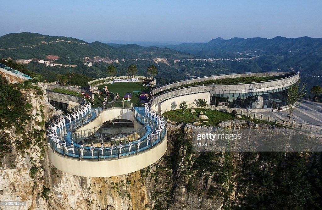 50 women practice yoga on the world's longest skywalk at the Longgang National Geologic Park on July 10, 2016 in Chongqing, China. The glass bridge extends 26.68 meters out from the cliff, about five meters longer than the skywalk at the Grand Canyon in the United States.