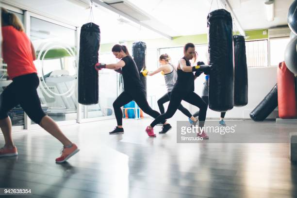 Women Practicing Boxing In The Gym