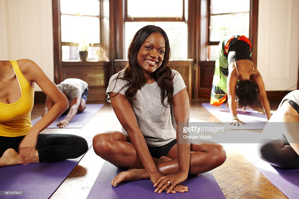 Women practicing yoga in class : Stock Photo