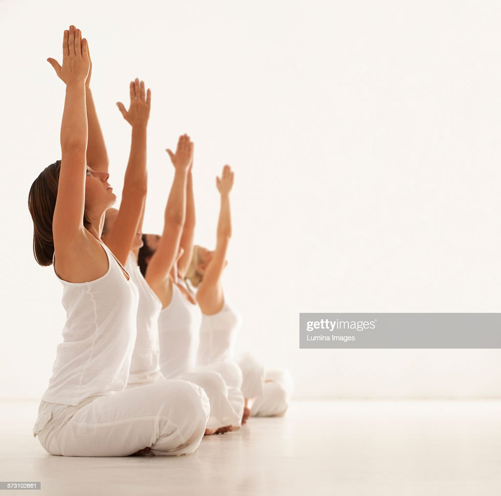 Women practicing yoga in class : Stock Photo