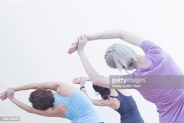 Women practising yoga