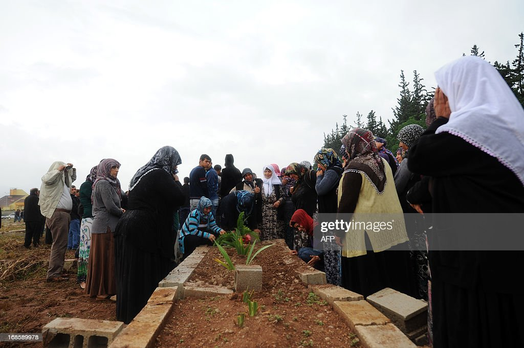 Women pray and mourn on May 12, 2013 at the graves of victims of a car bomb which went off on May 11 at Reyhanli in Hatay just a few kilometres from the main border crossing into Syria. Turkey was reeling from twin car bomb attacks which left at least 43 people dead in a town near the Syrian border, with Ankara blaming pro-Damascus groups and vowing to bring the perpetrators to justice. A Syrian minister denied on May 12 accusations that Damascus was behind a bomb attack in a Turkish town that left dozens dead, a day after Ankara blamed supporters of President Bashar al-Assad for the blasts.