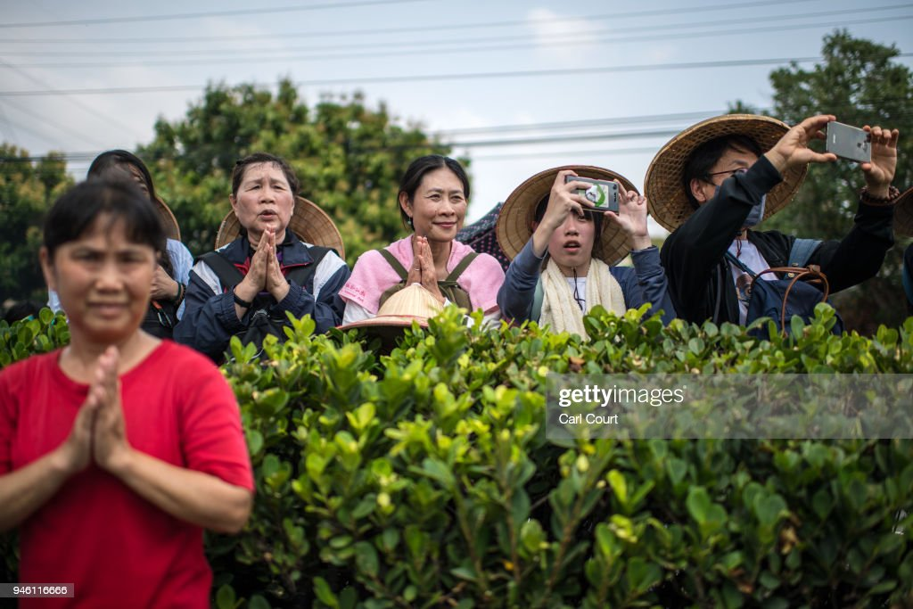 Women pray and take photographs as the sedan chair carrying a statue of the goddess Mazu is carried past on day two of the nine day Mazu pilgrimage on April 14, 2018 in Dadu, Taiwan. The annual Mazu Pilgrimage begins at Jenn Lann Temple in Taichung and sees around 200,000 pilgrims walk up to 12 hours each day for nine days carrying a statue of Chinese sea goddess Mazu in a sedan chair. The journey covers around 350 kilometres, much of it through mountainous and rugged terrain and visits more than 100 temples before returning to Taichung. The centuries-old pilgrimage is now recognised by UNESCO as living heritage and with an estimated 5 million participants spread over the nine days, it is considered to be one of the greatest religious festivals in the world.