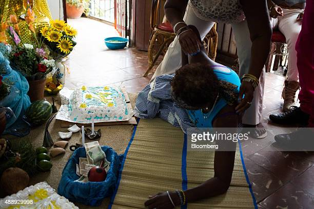Women pray at an alter during a Santeria celebration at a home in Havana Cuba on Wednesday Sept 17 2015 Cubans often pray to Catholic saints that...
