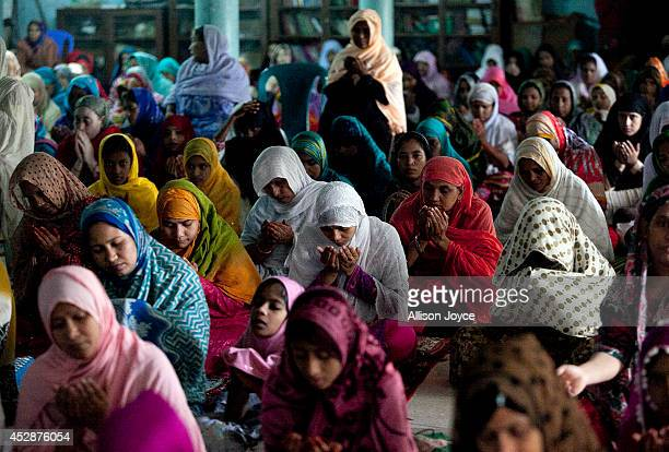 Women pray at the National Mosque Baitul Mukarram during Eid alFitr on July 29 2014 in Dhaka Bangladesh Muslims around the world are celebrating Eid...