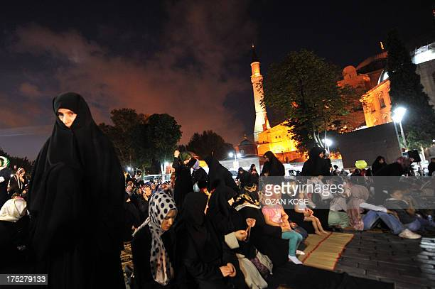 Women pray during a protest in support to ousted Egyptian President Mohamed Morsi at Hagia Sofia square on August 1 2013 in Istanbul AFP PHOTO / OZAN...