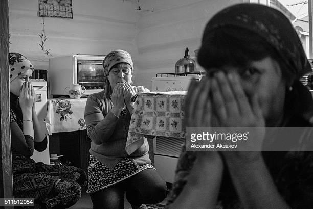 Women pray during Kurban Bayram in the village of Kuskurguli, Tyumen region, Russia. In Zabolotie Kurban Bayram can be celebrated during several...