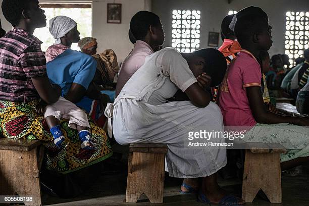 Women pray during Sunday service at Mofolo Woyera church in the village of Mulele which lies in one of the areas most affected by drought on...