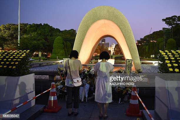Women pray for the victims of the 1945 atomic bombing at the Peace Memorial Park in Hiroshima on August 6 2015 Japan on Thursday marks the 70th...