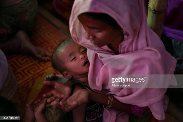 COX'S BAZAR BANGLADESH JANUARY 19 Women pray on January 19 2018 in Cox's Bazar Bangladesh In the refugee settlement of Balukhali over 116 widows and...