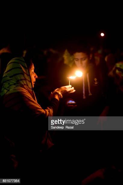a women praying during ganga sagar fair - ganga sagar stock photos and pictures