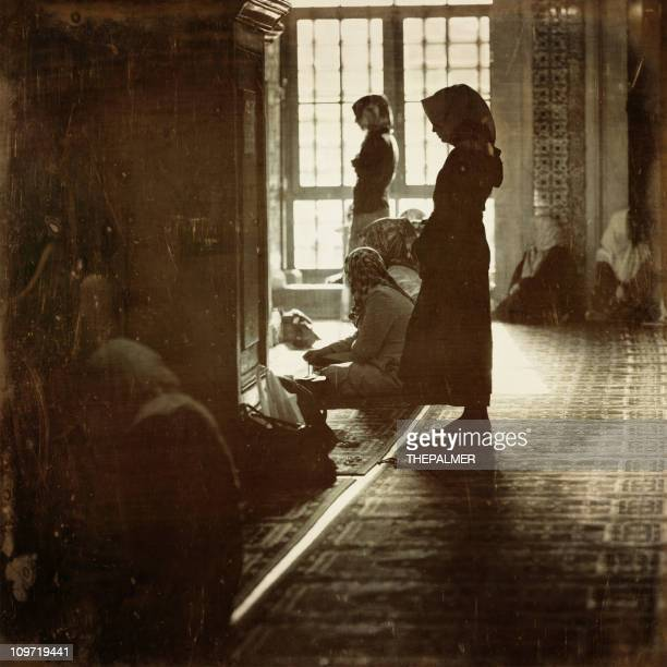 women praying in istanbul mosque - muslim praying stock pictures, royalty-free photos & images