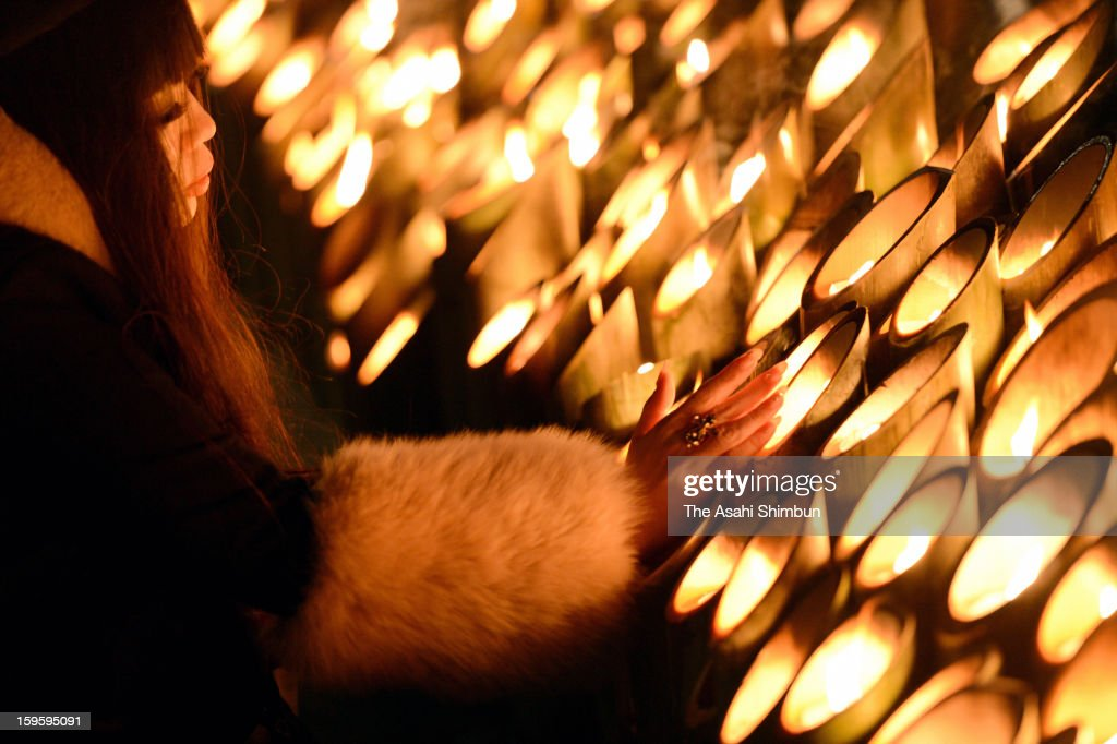 A women prays for the victims of 1995's Great Hanshin Earthquake at Higashi Yuenchi park on January 17, 2013 in Kobe, Hyogo, Japan. Memorial services were held to mark the 18th anniversary of the 1995 massive earthquake, hundreds of people gathered early this morning to pay their respects and light bamboo lanterns in the park for more than 6,400 people who lost their lives in the 7.3 magnitude earthquake.