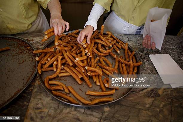 Women prepare bags of 'churros' for customers at Churreria Manueta during the fifth day of the San Fermin Running Of The Bulls festival on July 10...