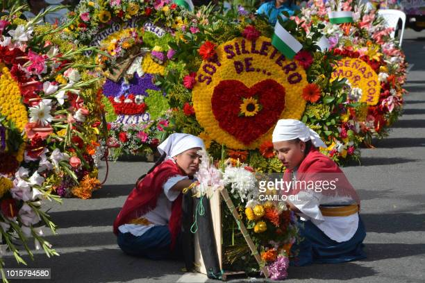 Women prepare flower arrangements before the traditional Silleteros parade held as part of the Flower Festival in Medellin Antioquia department...