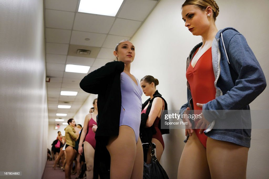 Women prepare for an audition at Radio City Music Hall for a spot with the Rockettes on April 30, 2013 in New York City. In order to be considered for the Rockettes, dancers must be at least 18 years old, measure at a height between 5 feet 6 inches and 5 feet 10 1/2 inches without their heels on. The dancers must also be be proficient in numerous dance styles, including jazz, tap and ballet. The women who make it through the extremely competitive competition to land a spot with the legendary dance group will perform in the Radio City Christmas Spectacular which runs from November 8 -December 30 2013.