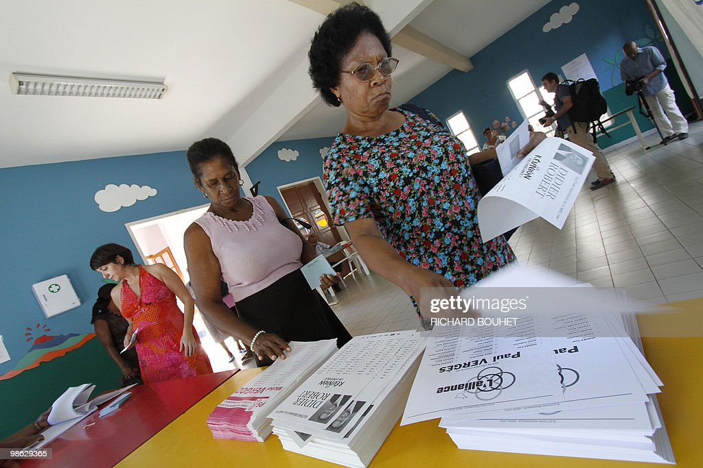 Women prepare to vote in the French Indian island of La Reunion, in a polling station on March 21, 2010 in Saint-Denis, during the second round of the French regional elections. President of La Reunion regional council, communist Paul Verges, 85, head of the left-wing parties faces right-wing UMP ruling party candidate, MP Didier Robert. French voters came out Sunday expected to deal French President a stinging rebuke in regional elections that will be his last big national test before seeking re-election in 2012.