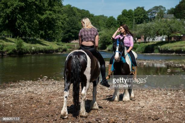 Women prepare to washe their horses in the River Eden on the opening day of the annual Appleby Horse Fair in the town of ApplebyinWestmorland...