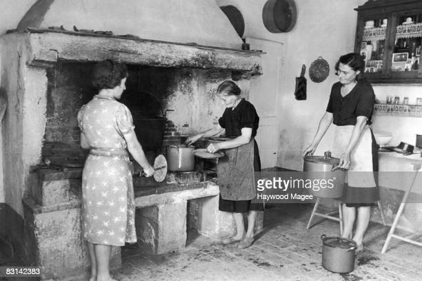 Women preparing a communal meal during the grape harvest on a latifundia farm in Strada near Chianti Italy 1st November 1947 Original Publication...