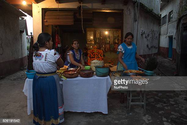 Women preparing food for the incoming tourists during the celebration of the Day of Dead in Janitzio Michoacan on November 1 2015