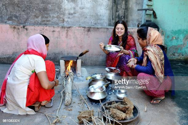 women preparing food on terrace - uttarakhand stock pictures, royalty-free photos & images