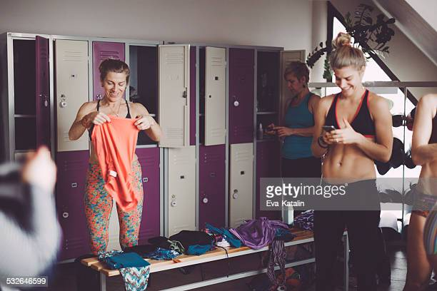 women preparing for yoga in the dressing room - dressing room stock pictures, royalty-free photos & images
