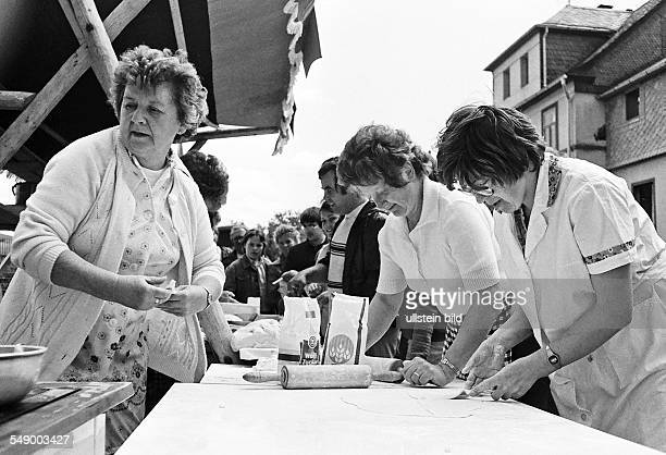 Women preparing local food called Kartoffelküchle on the occasion of the 20 th Worker's Festival Arbeiterfestspiele of the GDR in Bad Lobenstein