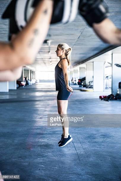 Women preparing to jump rope during boxing training