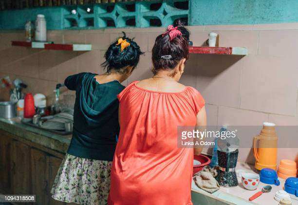 women prepping food in kitchen - mother in law stock pictures, royalty-free photos & images