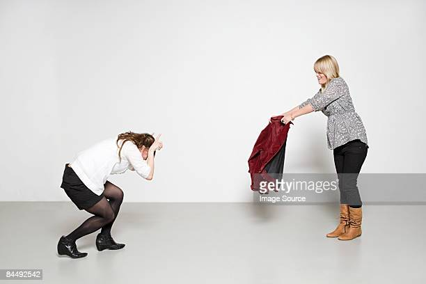 women pretending to be bull and bullfighter - animal representation stock pictures, royalty-free photos & images