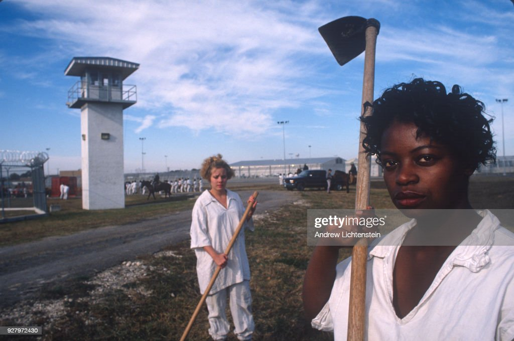 Women prisoners at the Mountainview Unit, a Texas state prison for women, work the fields of the prison farm in hoe squads on October 1, 1996 outside of Gatesville, Texas. The women keep time by singing in cadence songs about men, prison guards, and drugs.