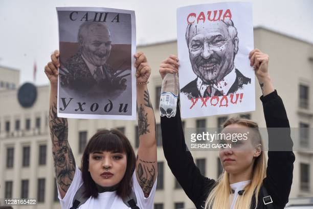 Women protest against disputed presidential elections results on Independence Square in Minsk on August 23, 2020. The placards depict Belarus'...