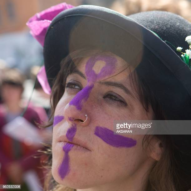 Women protest bare breasts to denounce inequality on March 8 2013 in Toulouse southern France The march is led by Famunis sort of Ukraine's Femen in...