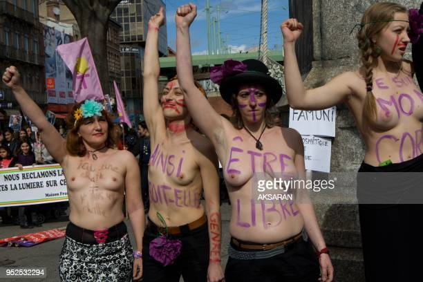 Women protest bare breasts to denounce inequality on March 8 2013 in Toulouse southern France The march is led by Famunis sort of Ukraine's 'Femen'...