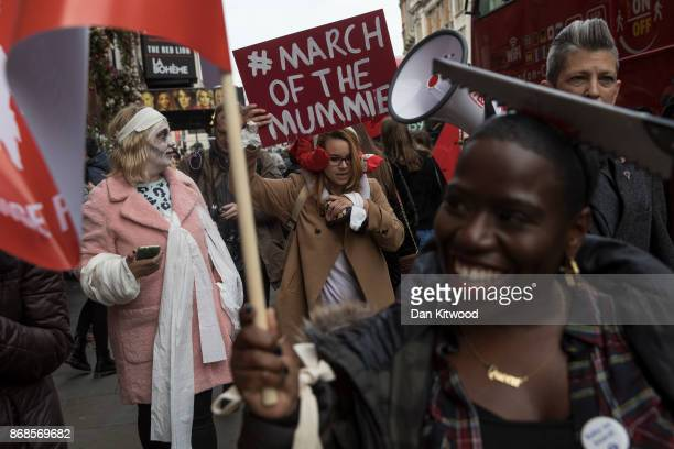 Women protest on Whitehall as they join a demonstration demanding rights for working mothers on October 31 2017 in London England Marches with women...