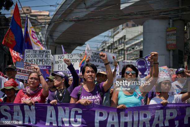Women protesters march the streets calling for an end to imperialism and to the Duterte regime to mark International Women's Day on March 8 2020 in...