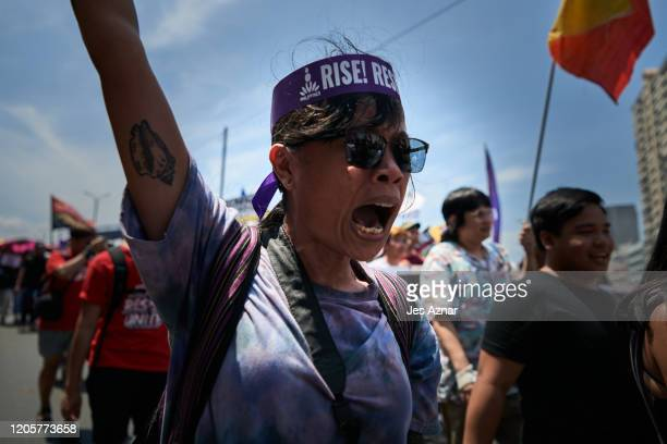 Women protesters march the streets calling for an end to imperialism and to the Duterte regime to mark International Women's Day on March 8, 2020 in...