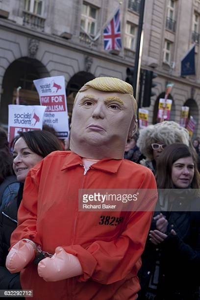 Women protesters march through central London as part of an international campaign on the first full day of Donald Trump's presidency on 21st January...