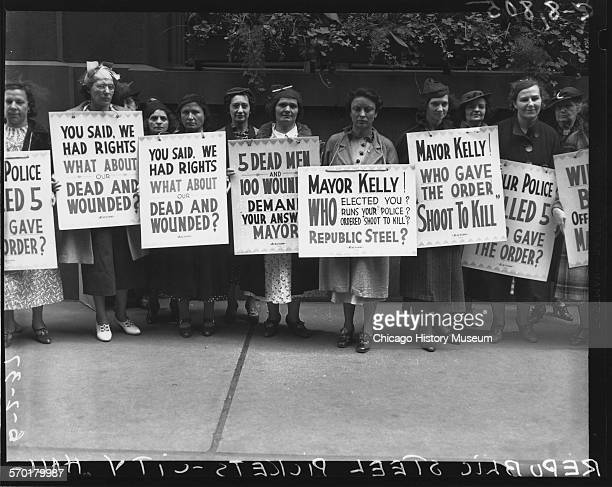 Women protesters picketing at City Hall in support of Republic Steel strikers after what is known as the Memorial Day massacre Chicago Illinois June...