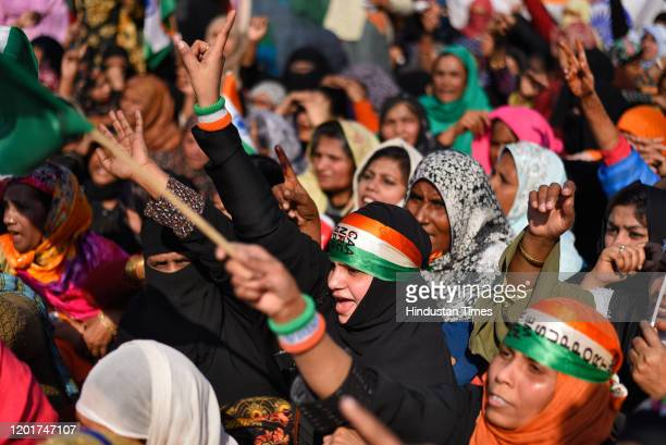 Women protesters raise slogans ahead of their march to Home Minister Amit Shah's residence, at Shaheen Bagh, on February 16, 2020 in New Delhi,...