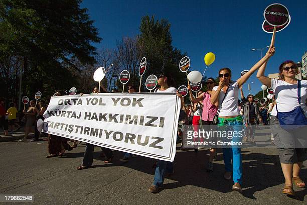 """Women protesting announce of abortion ban in Turkey march holding a banner which reads """"No compromise, no discussion, abortion is our right"""""""